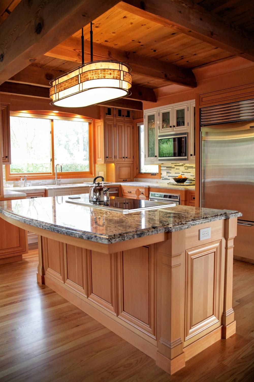 daniel miskie architect builder gwen kitchen island overhang web1